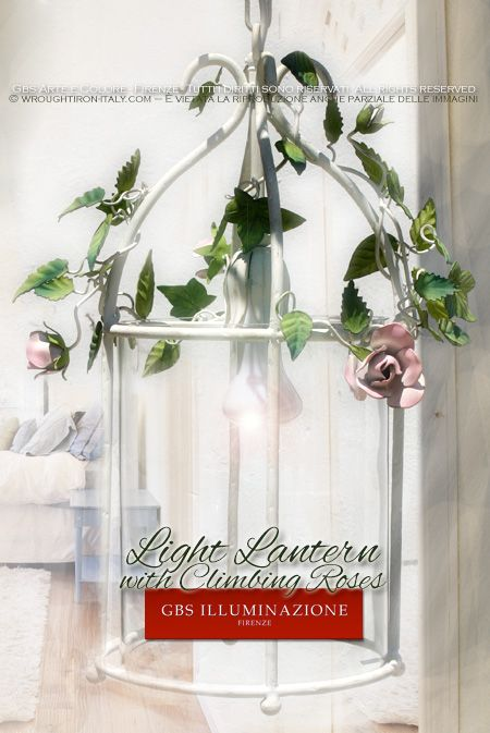 Light Lantern with Climbing Roses Cylindrical lantern with climbing Roses and rosebuds. Hand-decorated wrought iron. Made in Italy