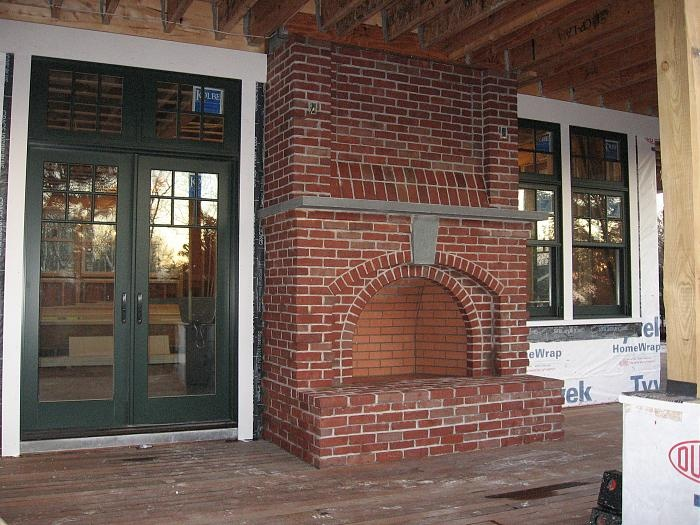 brick fireplace on screened porch