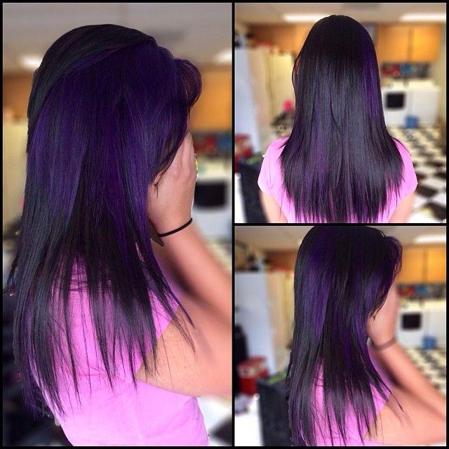 Dark hair. Purple peekaboos. Choppy cut.