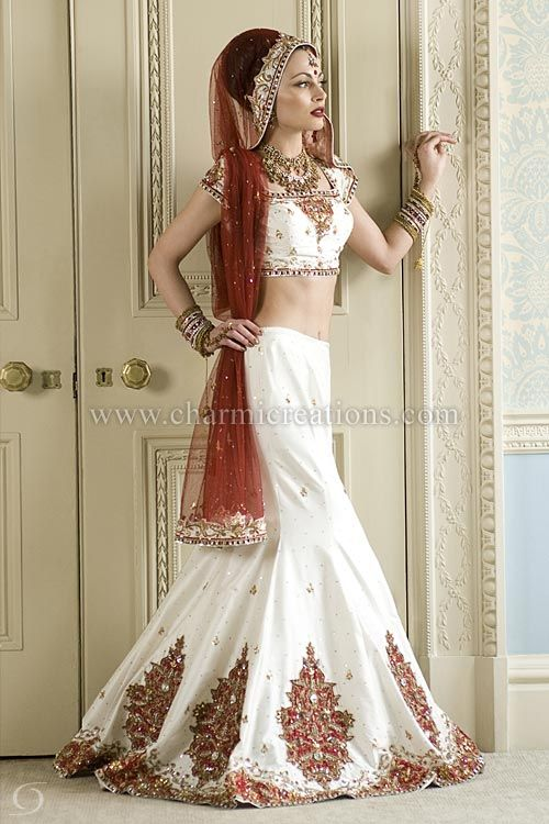 Indian Bridal Dresses - Off white raw silk 8 panelled wedding outfit with deep red patchwork and red net dupatta