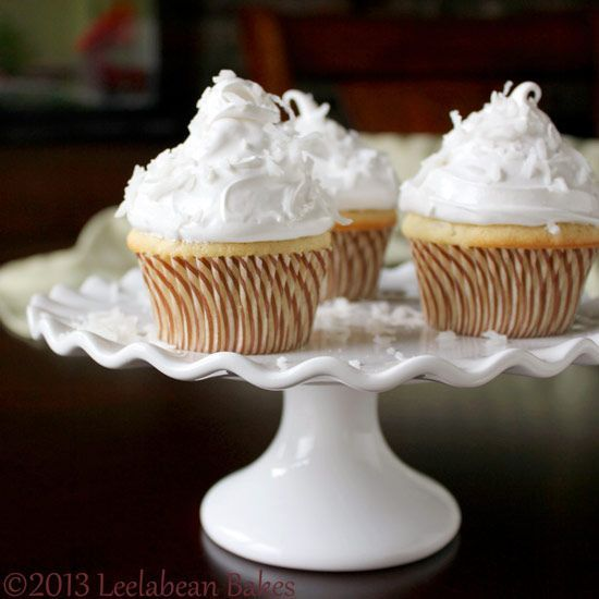 Ethereal Coconut Cupcake Recipe – perfect for a special occasion. Topped with Italian Meringue Frosting. #cupcake | http://yummycupcakescollections.blogspot.com
