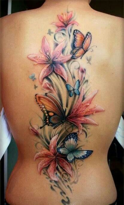 I love this floral butterfly tattoo--it's so realistic and looks like a painting!