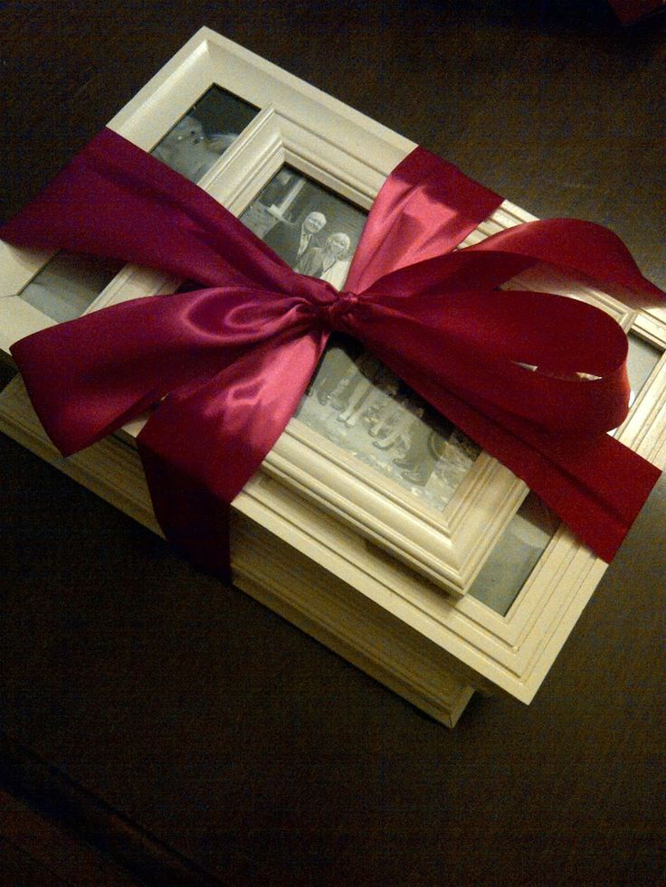 DIY Gift Idea: dollar store picture frames spray painted the same color filled with family photos for a gallery wall