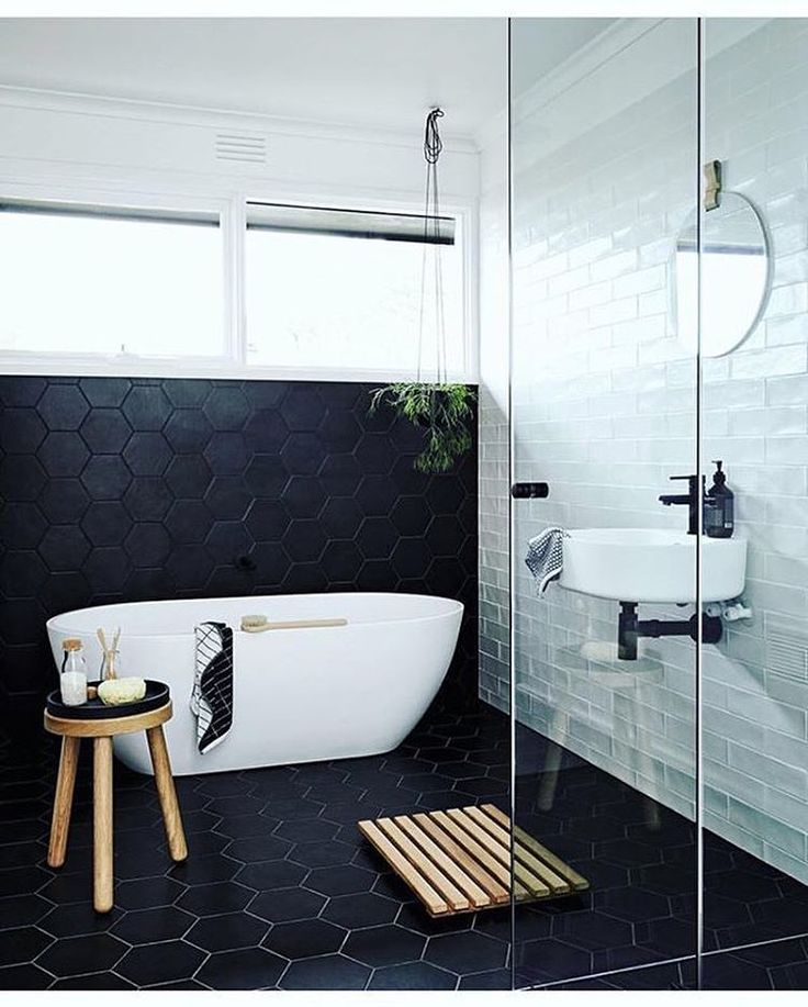 The selection of tiles in this beautiful @nord.house design are absolutely breathtaking. The mix of modern, hex charcoal tiles contrasted by the white subway tile feature wall creates a stunning combination! This amazing space boasts an elegant freestanding bath, frameless shower and a bold matte black basin mixer with matching exposed bottle trap. 📸 @doswellandmclean and the creative minds at @designstuff_group. meiraustralia#Meir #Meirblack #Meiraustralia #Blacktapware #Matteblacktapware