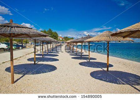 Island of Vir beach umbrellas, Dalmatia, croatia by xbrchx, via Shutterstock