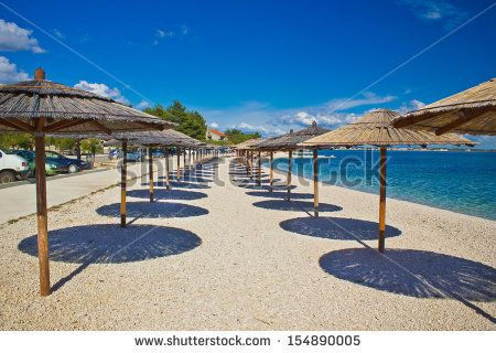 Island of Vir beach umbrellas, Dalmatia, croatia by xbrchx, via Shutterstock