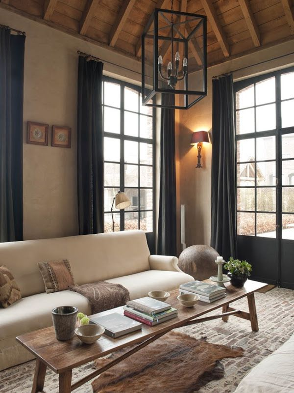 I love the dark steel windows, old floors and ceilings, and soft walls and natural linen upholstery. From: Belgian Pearls