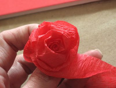 DIY Crepe Paper Roses - This is one of the best tutorials for making crepe paper roses.  Inexpensive and pretty easy to make with just a little practice.  Hot glue them on a styrafoam sphere to create a kissing ball (pomander) or join each rose to a wire stem with floral tape to make a bouquet, wreath or garland.  #LoveYourDiningRoom