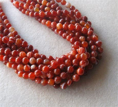 *  red orange striped agate round beads   *  agate gemstone   *  full strand, 8mm   *  47-50 beads per strand   *  jewelry making beads   These bright, highly polished beads will make any jewelry design stand out in the crowd! Must see to appreciate!   Each strand will be randomly selected from the group pictured.   All sizes are approximate.   Although colors show true on my monitor they may show different on yours due to the color calibration of each individual monitor.   PLEASE NOTE…