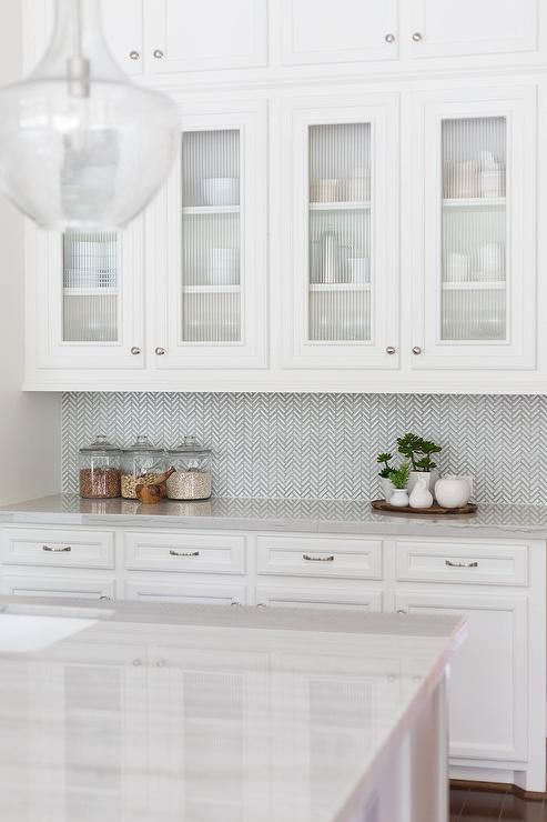 White And Gray Kitchen Features White Cabinets Paired With New Macabus White Quartzite Countertops And A