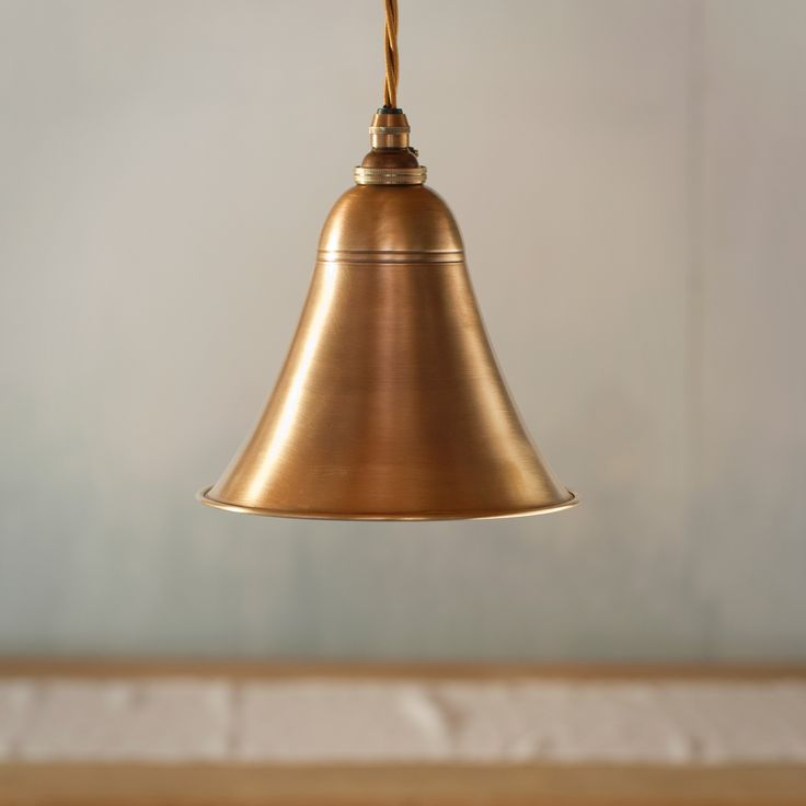 An attractive #brass pendant #light, with a #stylish #metal #shade which has simple detailing. It would be a great addition to any room such as a hallway or dining room.