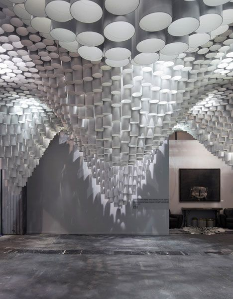 Paper Chandeliers - An undulating canopy of cardboard tubes by American studio Cristina Parreño Architecture and students from MIT hovered over visitors at the ARCOMadrid art fair in Spain. via Dezeen