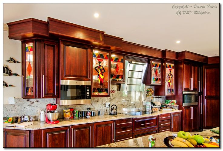 Designer Kitchen in Solid Mahogany....  www.geppettoswoodcraft.co.za