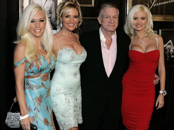 Playboy magazine publisher Hugh Hefner, 2nd right, and guests arrive for the LG Mariah Carey and Jermaine Dupri Post Grammy Party at a private residence Wednesday, Feb. 8, 2006