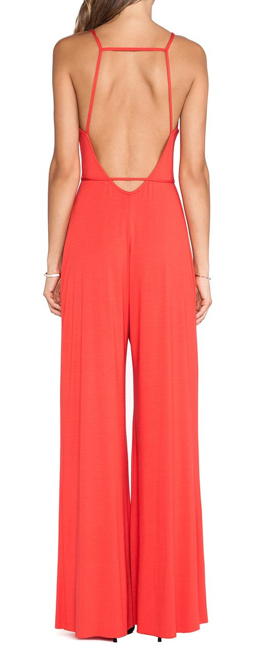 Coral jumpsuit Remind me of the Halston wide jersey pants and tops;-)