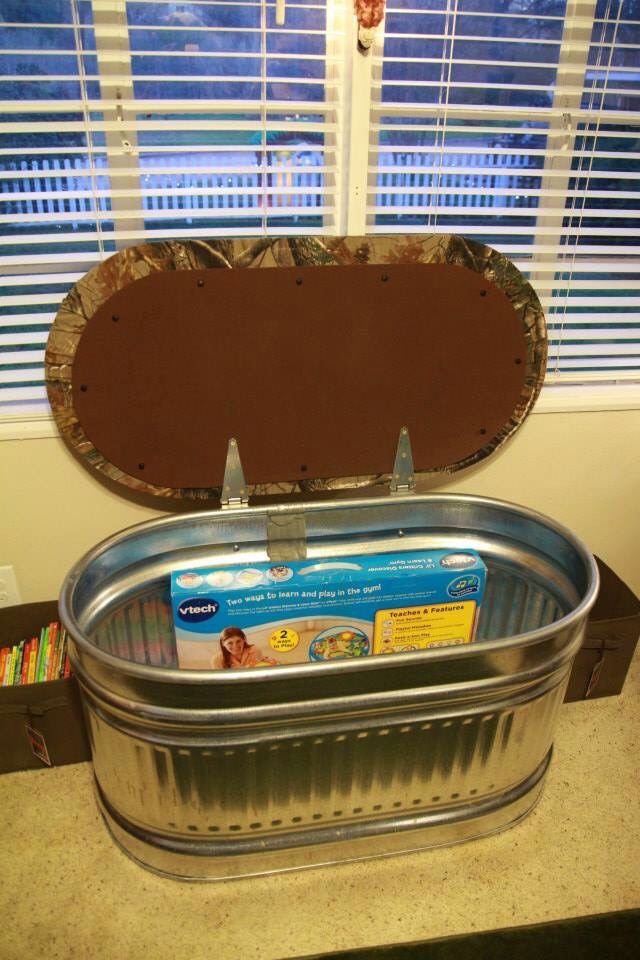 Toy box / window seat made out of a water trough in a hunting lodge nursery