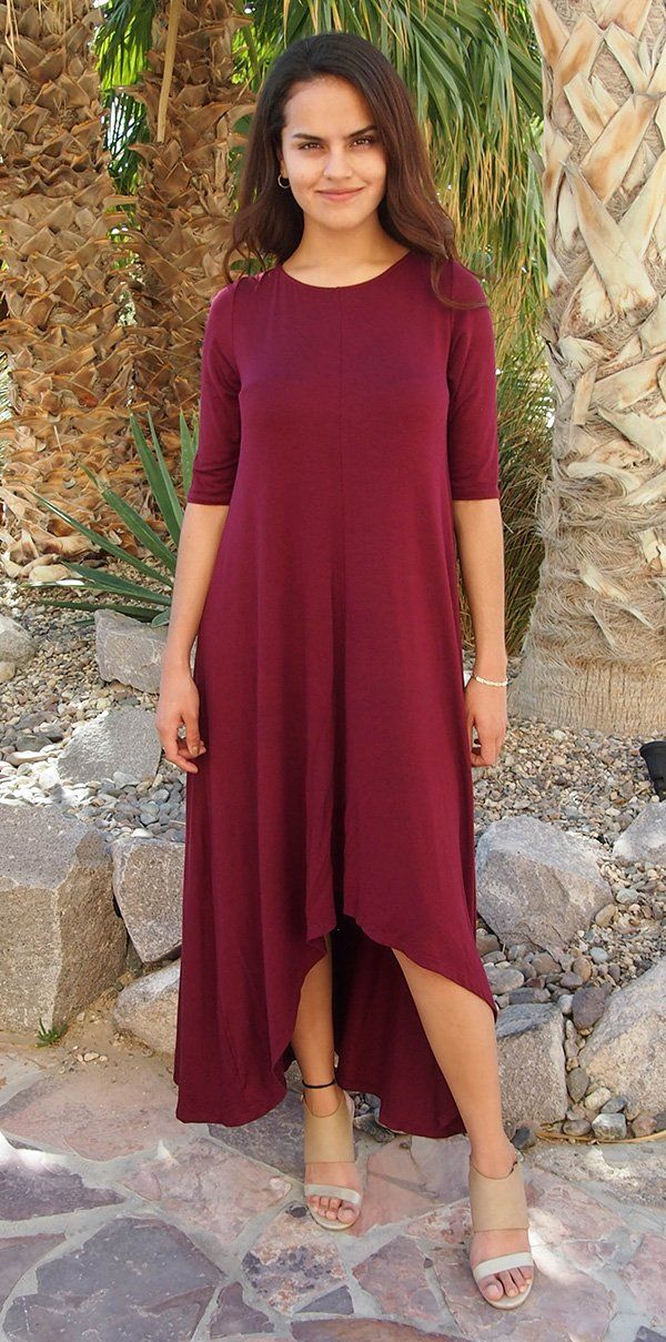 Feel like you are walking on air in our Swept Away Burgundy Red High-Low Maxi Dress. Super soft and stretchy jersey knit shapes a rounded neckline, relaxed fit bodice, three quarter long sleeves, and flowy hi low maxi skirt. Halter maxi dresses, short sleeve maxi dresses, off the shoulder maxi dresses, there is a maxi dress for everyone and every style of Maxi Dresses has it's perks! #burgundydress