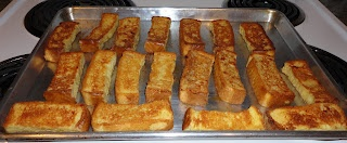 Baked French Toast Sticks  (One Crazy Cookie blog)  makes 36 sticks  -4 eggs  -1 cup powdered sugar  -1/2 cup milk  -1/4 cup maple syrup  -1/2 teaspoon ground cinnamon  -2 teaspoon vanilla  -12 thick (about 1 inch) sliced bread or Texas toast sliced bread  -3-4 Tablespoons butter (optional)
