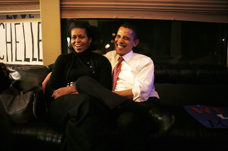 January 2, 2008 - JANUARY 2, 2008 U.S Senator Barack Obama (D-IL) and wife Michelle Obama take some time-out on their bus in Waterloo, Iowa on the last day of presidential candidates' campaigning before the Iowa caucus.  GETTY / PAUL J. RICHARDS/AFP