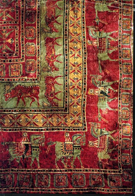 The Pazyryk rug: the oldest, nearly complete hand-knotted rug, 4th or 5th century B.C.E., found preserved in permafrost in a nomads tomb, southern Siberia, 1949. https://sites.google.com/site/ruginfoandcare/rug-history