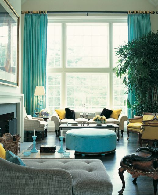 Colorful turquoise and yellow living room by designer Jamie Drake. Fabulous window treatments!