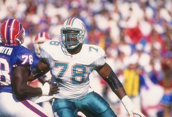 """Rather than literally take out an insurance policy on Dan Marino, the Dolphins decided to do the next best thing in the 1990 NFL Draft: draft offensive tackle Richmond Webb.  Webb came in at a monstrous 6'6"""", 325 pounds, and he put his build to good use. He served as Dan Marino's personal body guard for the duration of his 11-year career, making 118 consecutive starts in the trenches for Miami."""