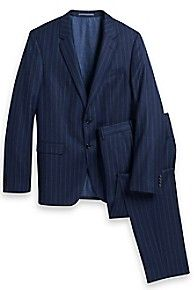 Tommy Hilfiger men's suit. Expertly crafted from four-season virgin wool, this designer favorite is distinguished by light structuring and slim silhouette-making it an agelessly sharp choice. Part of our Tailored Collection.• Slim fit.• 100% virgin wool.• Jacket fits slim with a 2 button closure, side vents, breast pocket, lined, soft shoulder.fitted and features a 2-button closure, double vented back, straight shoulder and full lining.• Trouser has a flat front, French pockets, and welt ...