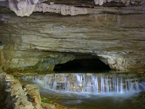 Waterfall inside War Eagle Cavern on Beaver Lake in Rogers, Arkansas. A gorgeous ancient cave that has a spring running throughout and has guided tours that are easily accessible for most people. They also offer more adventurous spelunking tours that go miles into the cavern! This cave has a large colony of bats and blind cave salamanders, too.