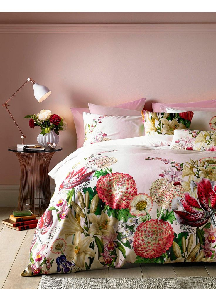 Ted Baker Encyclopaedia Floral Pair of Housewife Pillowcases Sleep in style with the newest collection from Ted Baker's Go to Bed with Ted range. No Ordinary Designer Label, Encyclopaedia Floral is a decidedly modern take on traditional designs and has been specifically designed to give your bedroom the dressing it deserves. On a pastel pink base, a range of exotic flowers burst from the edges of these pillowcases, with the vibrant reds and oranges of stargazer lilies blending with…