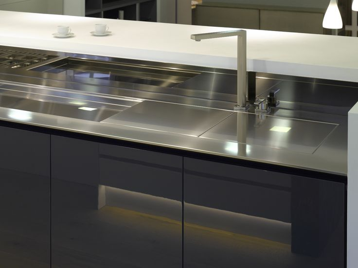 Stainless steel worksurface with closed sliding sink cover in Roundhouse bespoke Urbo kitchen