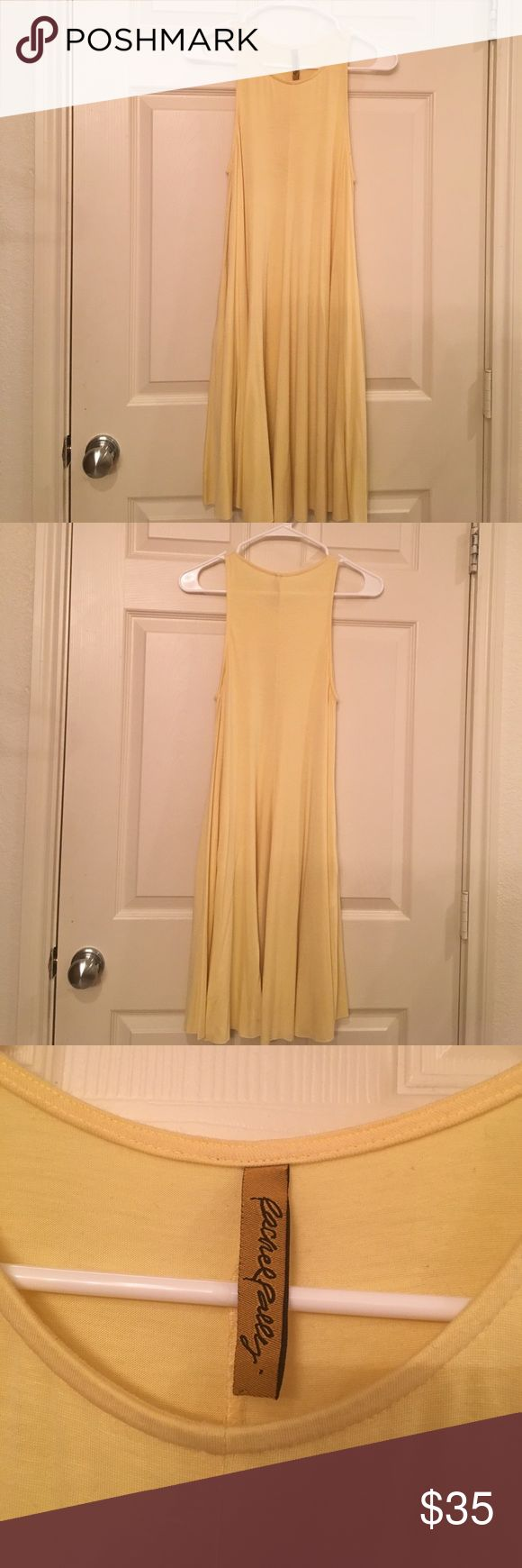 Yellow dress Rachel Palley dress bought new, gently worn. Some piling and a makeup stain near one armpit but it's not noticeable. It says size small but I'm a 10 and it fits me loosely. Rachel Pally Dresses Mini