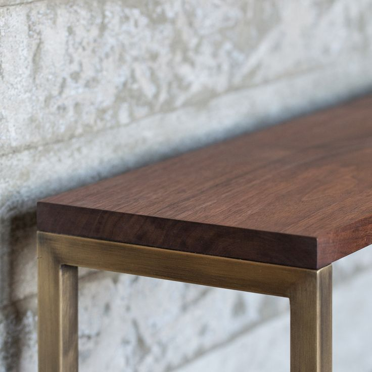 Elements Frame walnut console paired with a brass base.  .  .  #uhurudesign #homedecor