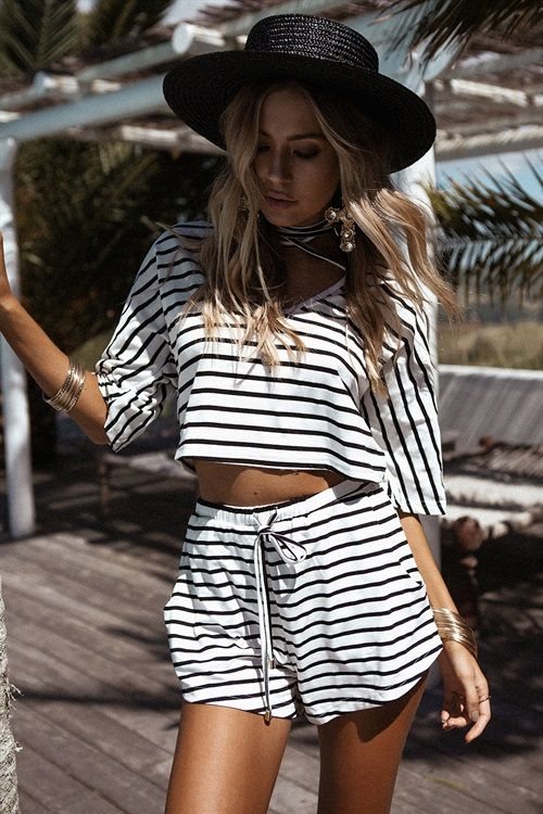The super cute Quinn Stripe Shorts are made from a soft off white fabric with horizontal black stripes throughout. They are a high waisted style and feature an elasticated waistband with drawstring and twin pockets at sides. Complete the look with the Quinn Stripe Top. By Sabo Skirt.