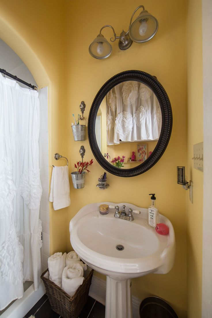 Small pails, cleverly hung beside the bathroom sink, make a perfect home  for a
