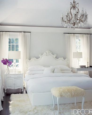 This picture is inspiring to me because I like how the interior designer was able to decorate everything in shades of white, yet the room is interesting and personalized because of the use of different textures. I also like the pop of color with the purple flowers.