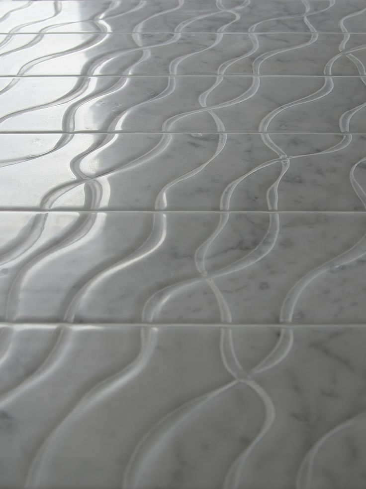 """DNA"""" is a fascinating waterjet cut pattern available in two different models accentuating its possibility to be installed in different ways: straight, reverse or intersected in the middle. The accuracy of the developed research has obtained the result to create, with only two models, a wall or a floor where the inlay-decoration features a continuous movement which is never repetitive."""