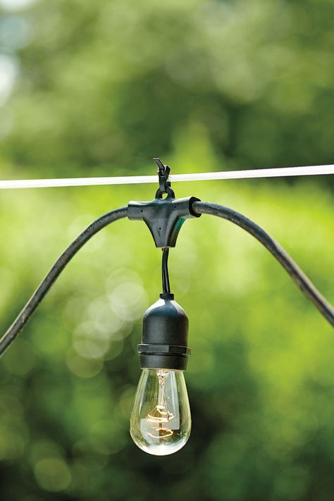 First, if you're stringing your lights across the yard, , then it's best to secure your string lights to a tension wire for additional support.