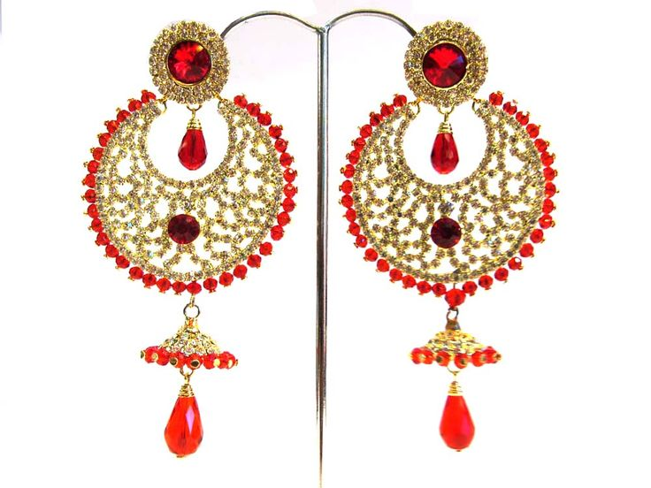 This is designer imitation earrings . the base of this earrings is made of brass & the upper design is covered with colourfull stones . Order Now  - click - http://www.rajranibangles.com/product-imitition-jewellery-1046.aspx
