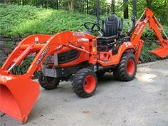 Kubota BX25D everything you need in a small tractor, I would rather it be a John Deere Tractor but this is the perfect set-up.