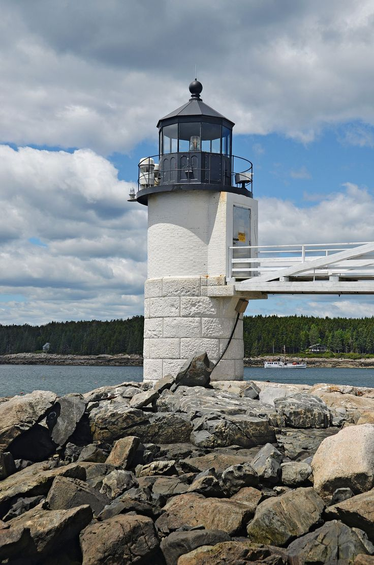 Marshall Point Lighthouse at the entrance of Port Clyde Harbor, Maine, USA. It was established in 1832. The original tower was replaced with the present lighthouse in 1857. The lighthouse was automated in 1980 and the original Fresnel lens was replaced with a modern 12 inches (300 mm) optic. This light station was added to the National Register of Historic Places in 1988.