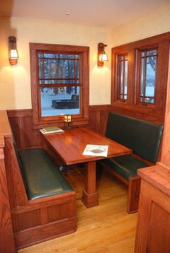 Duprey's favorite space in the house: the breakfast bay. The kitchen was small, but adding a small bay opened up the space. The next challenge was to find the right table for the breakfast bay. Duprey wanted the built-in table to have the right feel, and went from restaurant to restaurant in Ann Arbor trying out wooden booths.    He found the right fit with the front window booths at Arbor Brewing Co. He took the dimensions and the table and benches (only with leather seats) were re-created.