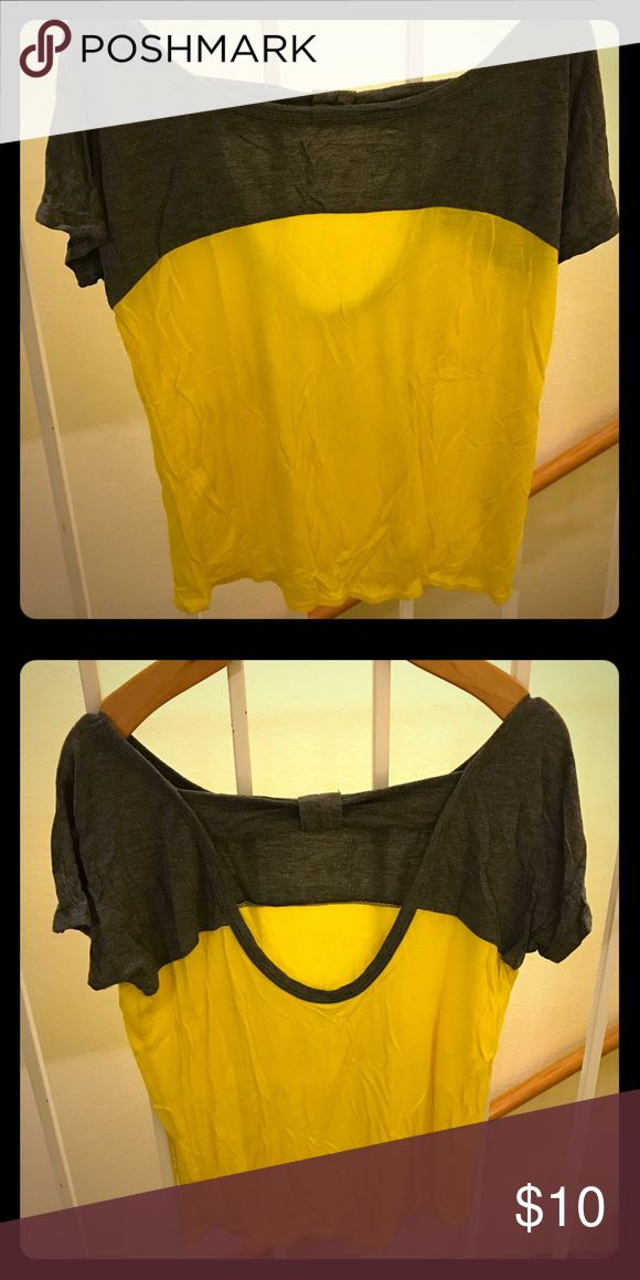 Color block slouchy tee Yellow and grey color block slouchy tee, perfect for spring! Francesca's Collections Tops Tees - Short Sleeve