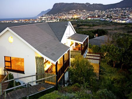 Self catering apartments, Clovelly, Cape Town  Overlook the bay with scenic sunsets and mountain views from the Clovelly Lodge