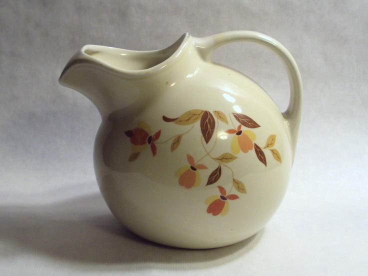 Vintage Hall China Jewel Tea Autumn Leaf Ball Jug Water Pitcher with Ice Lip. 26.00, via Etsy.