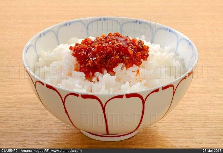 Seasoned Chinese red pepper oil on white rice - stock photo