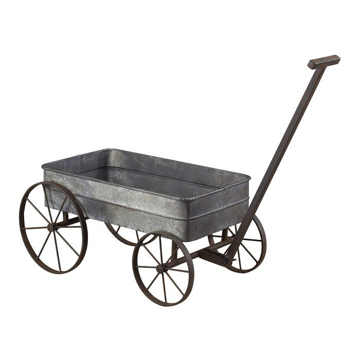 This handcrafted Sterling Industries Metal Cart Planter with Handle has a traditional design with great functionality. The rectangular shaped wheelbarrow design of the cart planter is used to place potted plants. The Metal Cart Planter with Handle from Sterling Industries is made from durable and sturdy metal. It has a gray distressed finish. The wheels of the cart planter make it easier to port from one place to another. The handle of the planter allows for easy maneuvering. It can be…