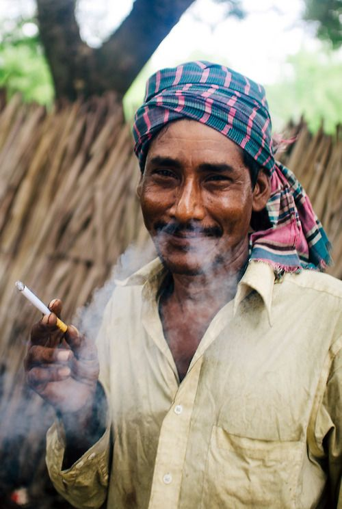 Smoke streams and smiles. Taken within the Sundarban National Park, near Khulna, Bangladesh.  #portrait #smile #smoking #travel #bangladesh