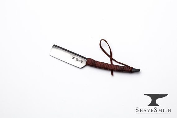 Please note: this design is made to order, and generally takes 2-3 weeks to forge out.  If youd like to customize this razor, here are some razor tip options: http://shavesmith.com/custom-straight-razor-options/  Cheers,  -Christopher   -------------------------------------------------------  A keen and smooth shaving Japanese style straight razor with leather wrapped handle, slight curve to the handle. This razor is expertly forged, honed, & ready for use right out of the box…