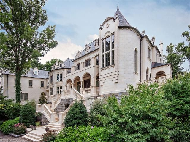 """An elegant French chateau constructed of 3"""" thick limestone and the utmost quality styled for today. A complete Roman Spa, entertainment area with card..."""