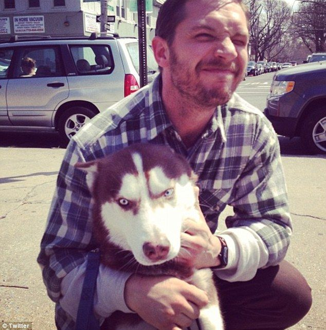 Tom can't resist a hug with a icy-eyed husky on the streets of New York